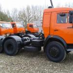 КамАЗ 54115 в профиль оранжевый