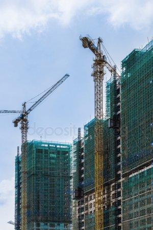Две строительные краны — стоковое фото